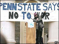 Student from Pennsylvania state university stands before huge anti-war banner