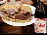 Beef sandwich and bottle of Beaujolais wine