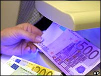 Euro notes under an ultraviolet scanner