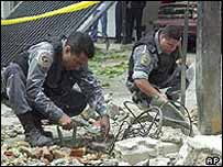 Police scour the scene of the blast