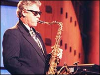 Clinton plays the sax