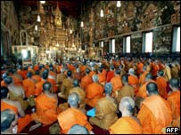 Thai Buddhist monks at the Emerald Buddha temple in Bangkok