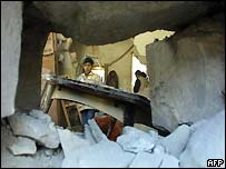 A young Palestinian boy surveys the remains of a building in Nablus