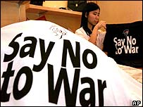 Anti-war t-shirts are sold through the office of the Star, a local English newspaper, in Kuala Lumpur, Malaysia.