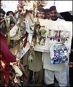 Pakistani fans burn pictures of the players