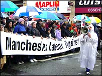 Protesters at the head of one of three marches in Manchester