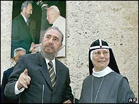 Fidel Castro is welcomed by the head of the order of the Most Holy Saviour of St Birgid, Tekla Famiglietti