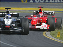 Kimi Raikkonen holds off Michael Schumacher during the Australian Grand Prix