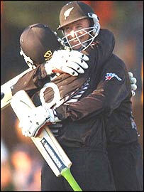 Nathan Astle is hugged by Chris Harris
