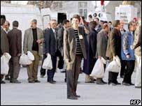 Election officials queue at election count
