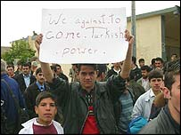 Anti-Turkish demonstrators holds up sign at protest in Irbil