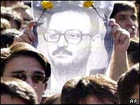 Students hold up a picture of the reformist university lecturer, Hashem Aghajari