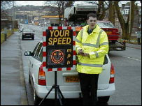Policeman with speeding sign