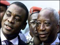 Former Prime minister Affi N'Guessan (left) of Ivory Coast talks to the new Prime Minister Seydou Diarra