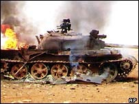 Iraqi tank on fire, 1991 Gulf War
