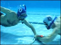 Underwater hockey players - image CBC