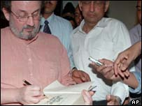 Salman Rushdie signing copies of The Satanic Verses.
