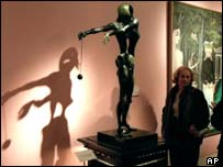 A sculpture by Salvador Dali exhibited at Sotheby's auction house in Paris