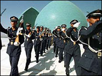 Soldiers parade in front of the memorial to the Iran-Iraq war in Baghdad
