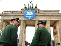 Greenpeace activists install a anti-war banner at the Brandenburg gate in Berlin