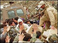 Kurdish refugees wait for food rations after 1991 Gulf War