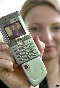 Woman holding camera phone