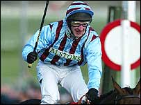 Jockey Jim Culloty celebrates after riding Best Mate to his second Cheltenham Gold Cup
