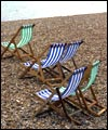 Deckchairs on Brigton beach, Sussex, England
