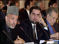 President Karzai (from left) with Foreign Minister Abdullah Abdullah and UN envoy Lakhdar Brahimi