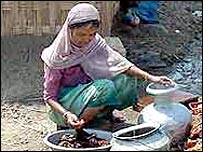 A woman collect water in Bangladesh