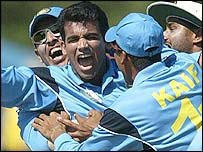 Zaheer Khan (centre) is congratulated by his team-mates