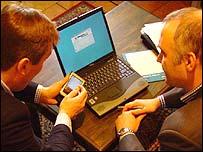 Businessmen around a laptop