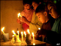 A family in Jordan light candles for peace