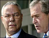 Colin Powell (L) with President Bush