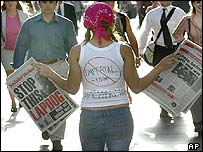 Sydney anti-war protester with newspapers