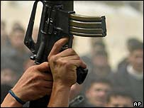 An M-16 rifle is held aloft by Palestinians