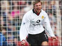 David Beckham celebrates after putting Manchester United in front at Villa Park