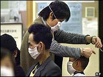 Masks are put on patients waiting in the emergency ward of a Hong Kong hospital
