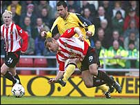 Kevin Phillips is brought down by Bolton's Florent Laville
