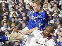 Everton's Steve Watson challenges West Ham's Trevor Sinclair