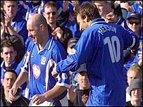 Steve Stone (left) celebrates his winner at Fratton Park, with the help of Paul Merson
