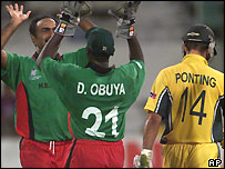 Obuya and Karim celebrate Ponting's wicket