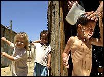 Children being washed in Venezuelan shanty town