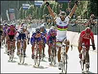 Mario Cipollini celebrates his opening stage victory