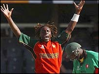 Henry Olonga celebrates his dismissal of Kenya's Kennedy Otieno