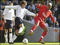 Mauricio Taricco challenges Liverpool's El Hadji Diouf for the ball