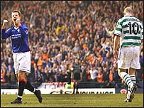 Barry Ferguson celebrates after John Hartson's penalty miss