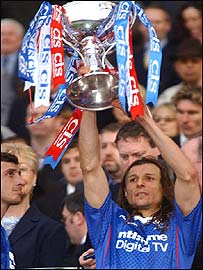 Goalscorer Claudio Caniggia shows off the League Cup