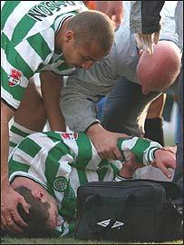 Chris Sutton lies injured at Hampden during the CIS Cup final