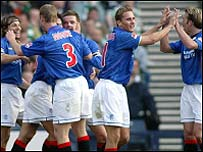 Rangers celebrate as they take a two-goal lead